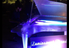 A piano with lights in an Austin park during SXSW 2014.