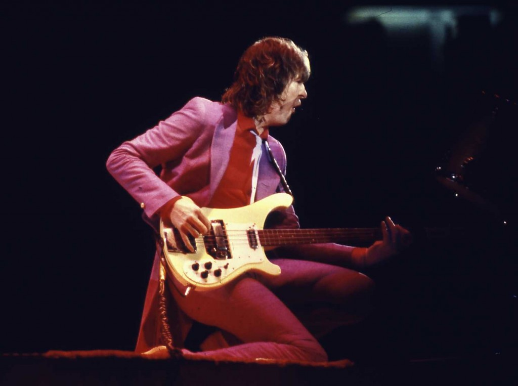 "In this circa 1979 photo, Chris Squire plays bass during a Yes concert in Champaign, Ill. Squire, co-founder of the progressive rock band Yes who recently announced he had leukemia, has ""peacefully passed away,"" according to band members. (David Boe / Associated Press)"
