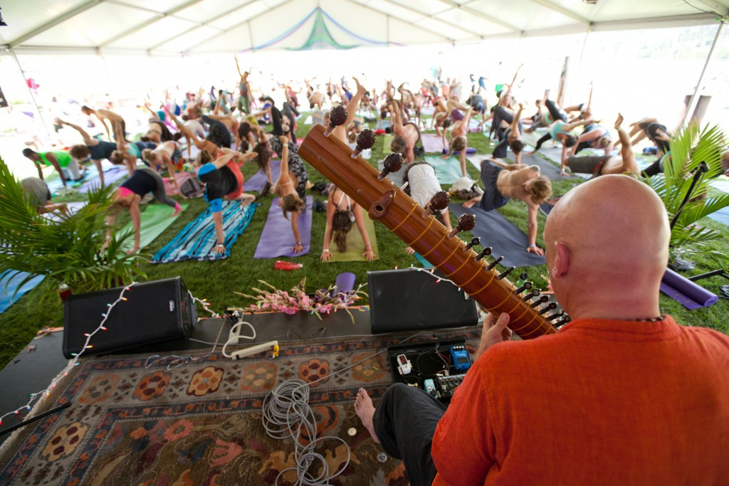Festivalgoers participate in a yoga workshop during the 2014 Arise Music Festival. The third iteration of the event is set for Aug. 7-9. (Michael Nyffeler / Courtesy photo)