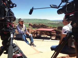 Chris Daniels, left, is interviewed at Red Rocks Amphitheatre by producer Lee Aronsohn for a documentary about 1970s Boulder band Magic Music. (Magic Music Movie LLC / Courtesy photo)
