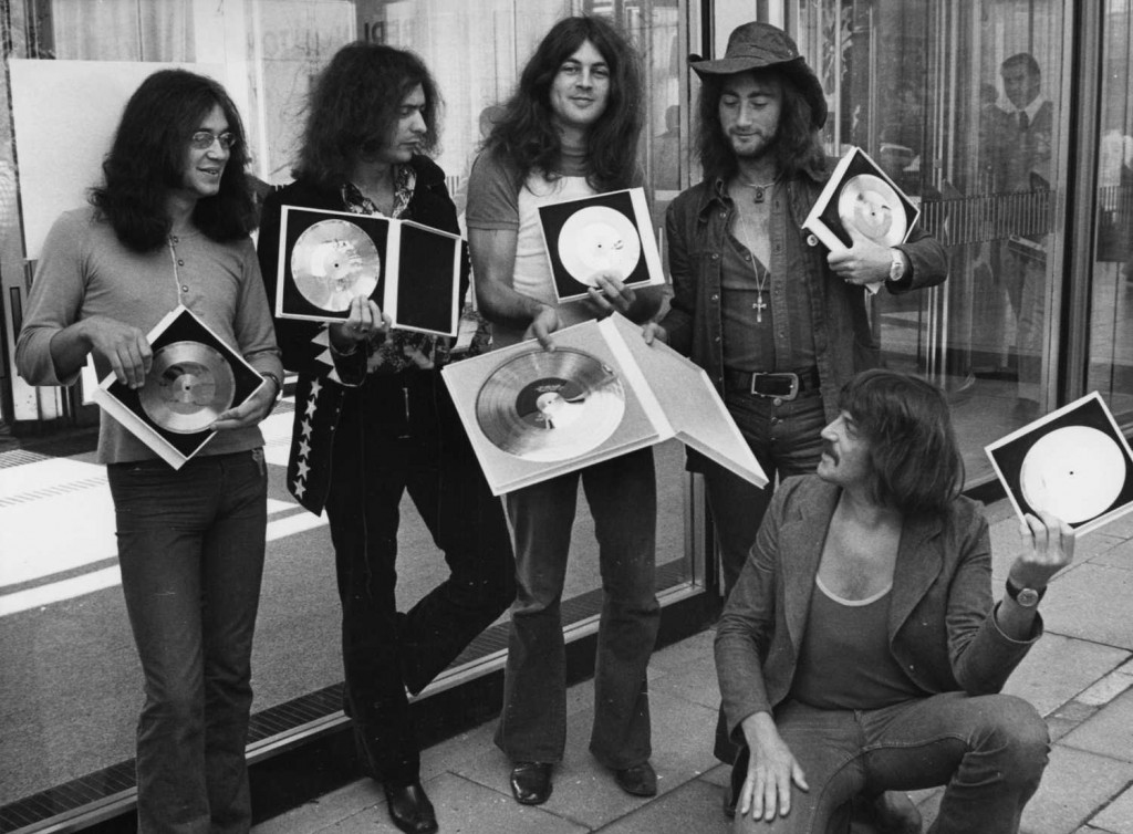 "In this Sept. 1, 1971, photo, British rock band Deep Purple present the gold record they received in West Berlin for the sales of their album, ""Deep Purple in Rock."" The band will be inducted into the 2016 class at the Rock and Roll Hall of Fame on April 8. (Edwin Reichert / Associated Press file photo)"