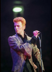 "David Bowie, shown during a 1997  concert celebrating his 50th birthday, not only sang ""Fashion,"" he exuded fashion sense.  (Ron Frehm / Associated Press)"