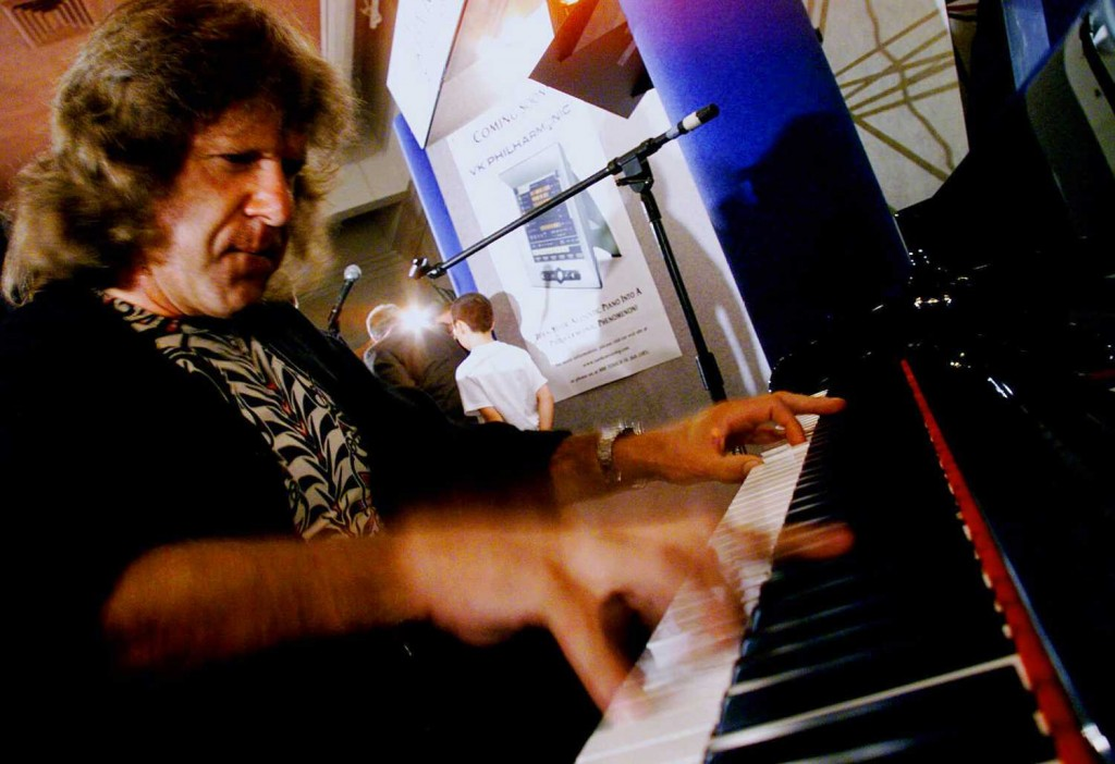 In this 1999 file photo, musician Keith Emerson plays the new Van Koevering Interactive Piano, designed by electronic engineer Bob Moog, in Beverly Hills, Calif. (Damian Dovarganes / Associated Press)