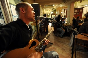 Jeff Brinkman entertains diners during the monthly event to feature a local artist at Breadworks in Boulder, Colorado