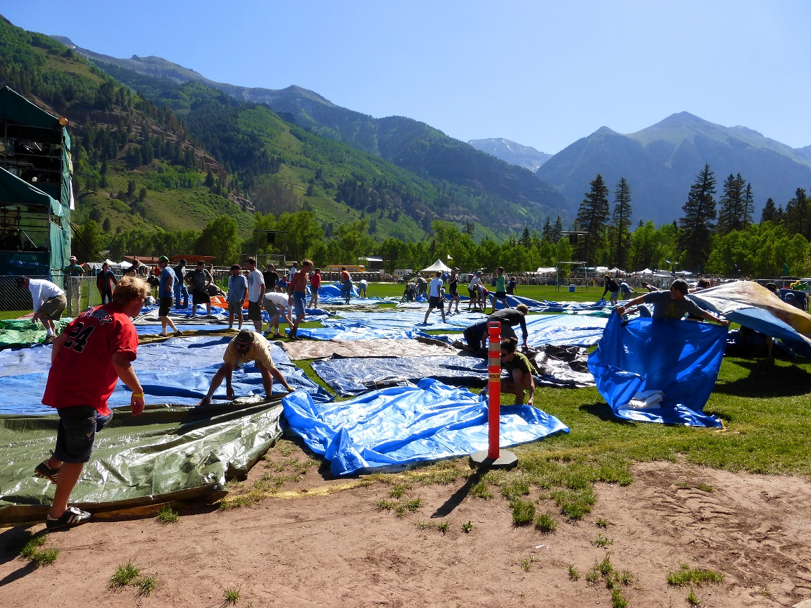 The running of the tarps opens the 40th Telluride Bluegrass Festival June 20. (Photo by Hans Lehndorff)