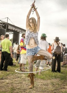 """Hula hoop dancers started appearing at jamband shows 10-15 years ago, says photographer Jay Blakesberg. He took this image, featured in his book """"Hippie Chick,"""" during Summer Camp Music Festival in Chillicothe, Ill., in May 2014. (Jay Blakesberg / Courtesy photo)"""
