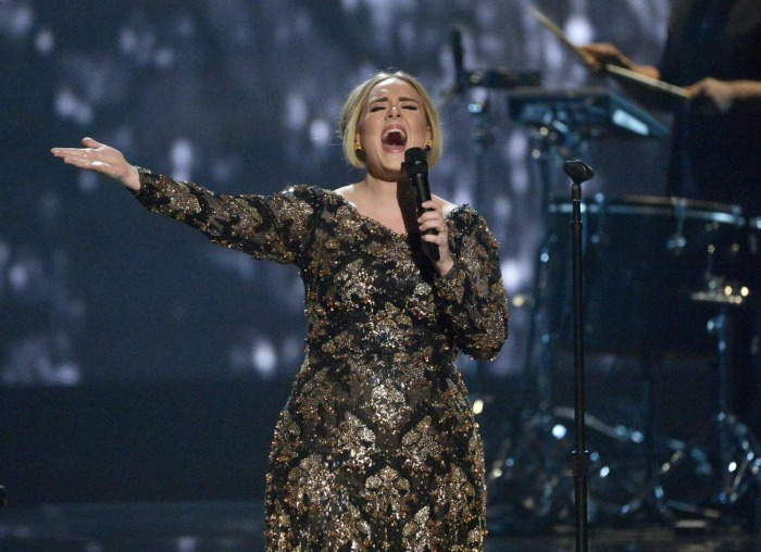 Adele, shown during a November 2015 concert at Radio City Music Hall, will perform during the Grammy Awards. Her music will be eligible for the 2017 Grammys. (Virginia Sherwood / Associated Press, NBC)