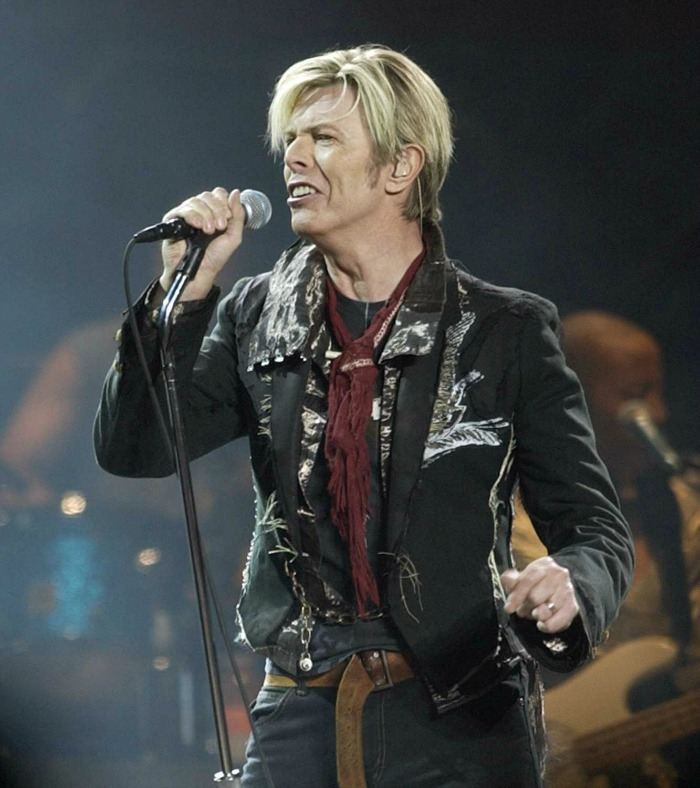 "The impact of singer/songwriter David Bowie, shown launching the U.S. leg of his 2003 ""A Reality Tour,"" extended beyond music to pop culture. (Kathy Willens / Associated Press)"